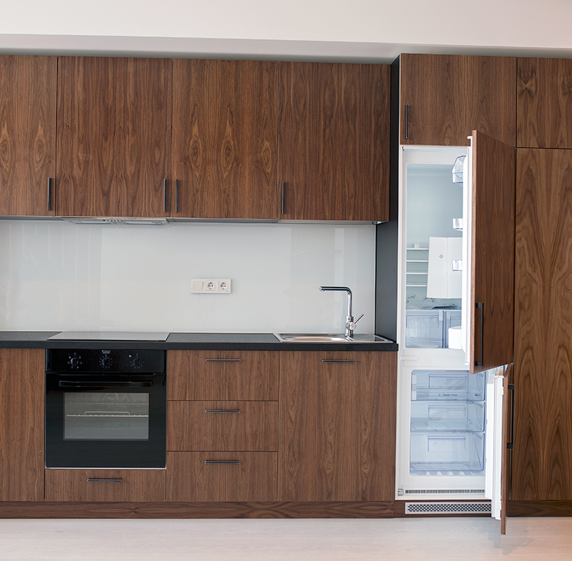 Kitchen from the collection of simple lines, veneer American walnut and chipboard Egger