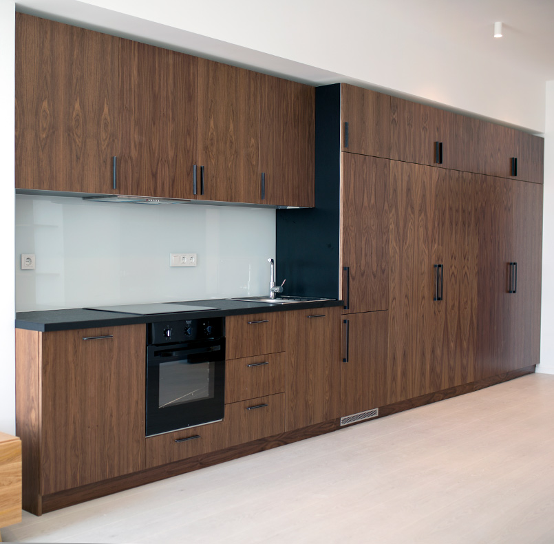 Kitchen combination of simple lines and a collection of cabinets, veneer American walnut, Egger chipboard